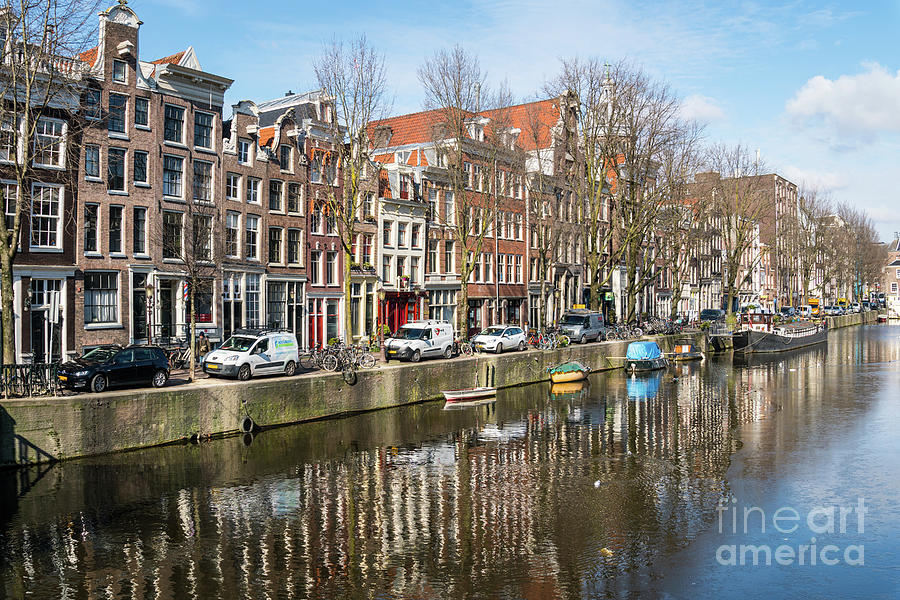 The famous canals in Amsterdam old town on a sunny winter day in by Didier Marti