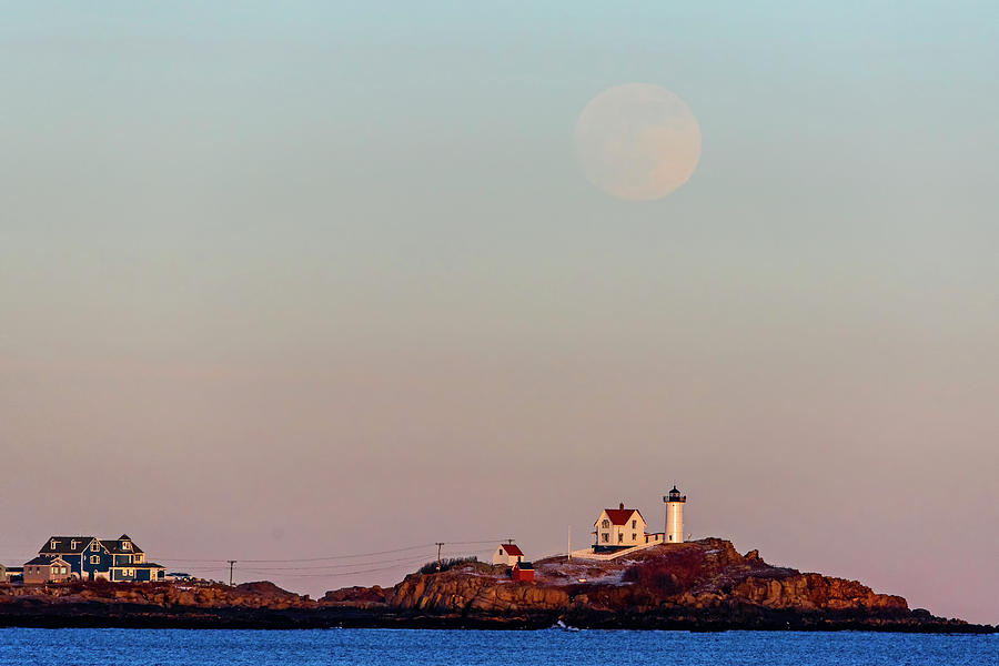 The full moon rises over the Nubble Lighthouse York Beach Cape Neddick Maine by Toby McGuire