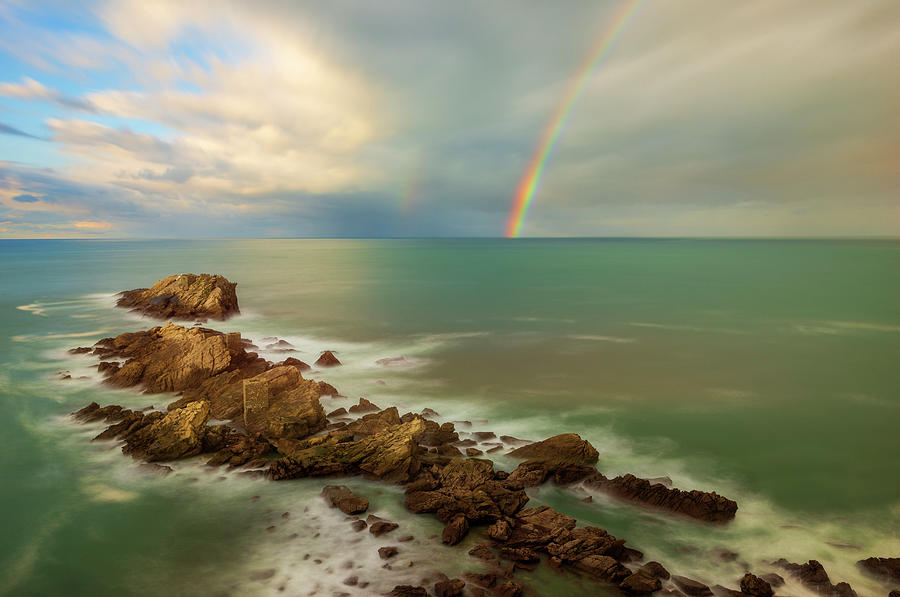 The rainbow on the coast of Zarautz in Guipuzcoa by Vicen Photography