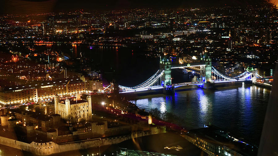 The Tower Bridge in London at Night by Santosh Puthran