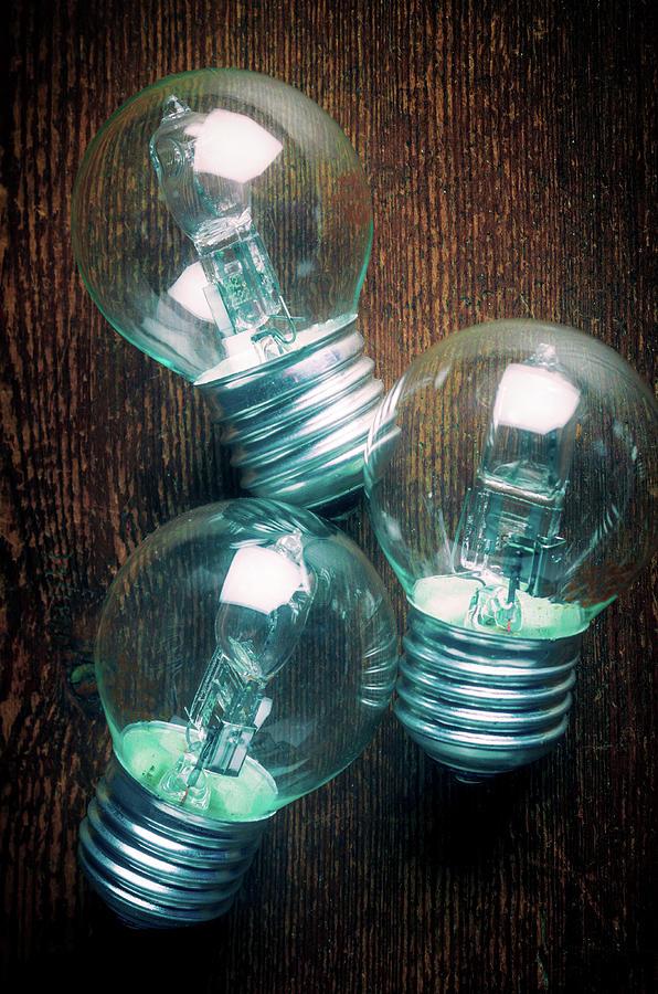 Three Bulbs Over Wood by Carlos Caetano