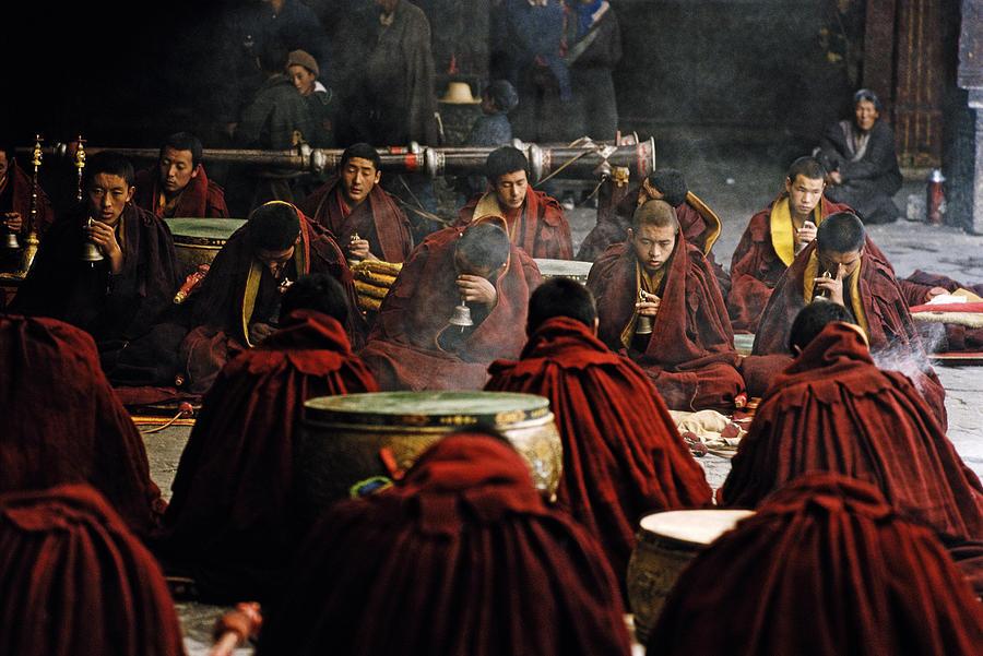 Tibet, Lhasa, monks chanting at Jokhang temple Photograph by Christopher Pillitz