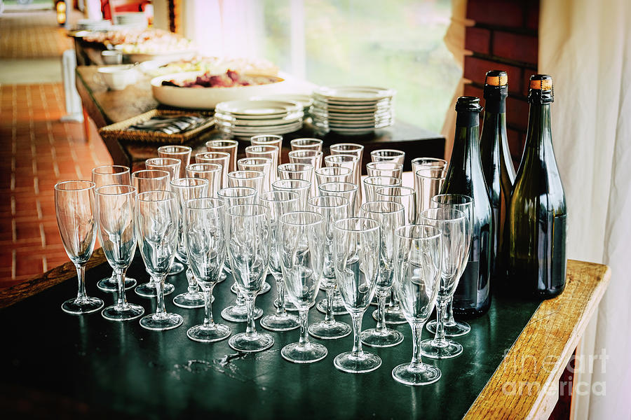 toasting many glasses for anniversaries empty goblets chalices before the toast at the restaurant to celebrate anniversary by Luca Lorenzelli