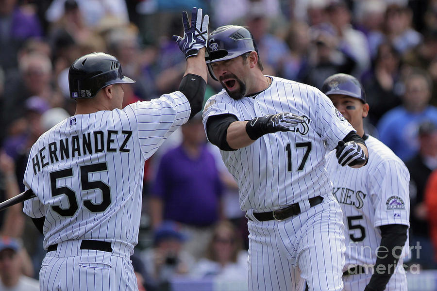 Todd Helton and Ramon Hernandez Photograph by Doug Pensinger