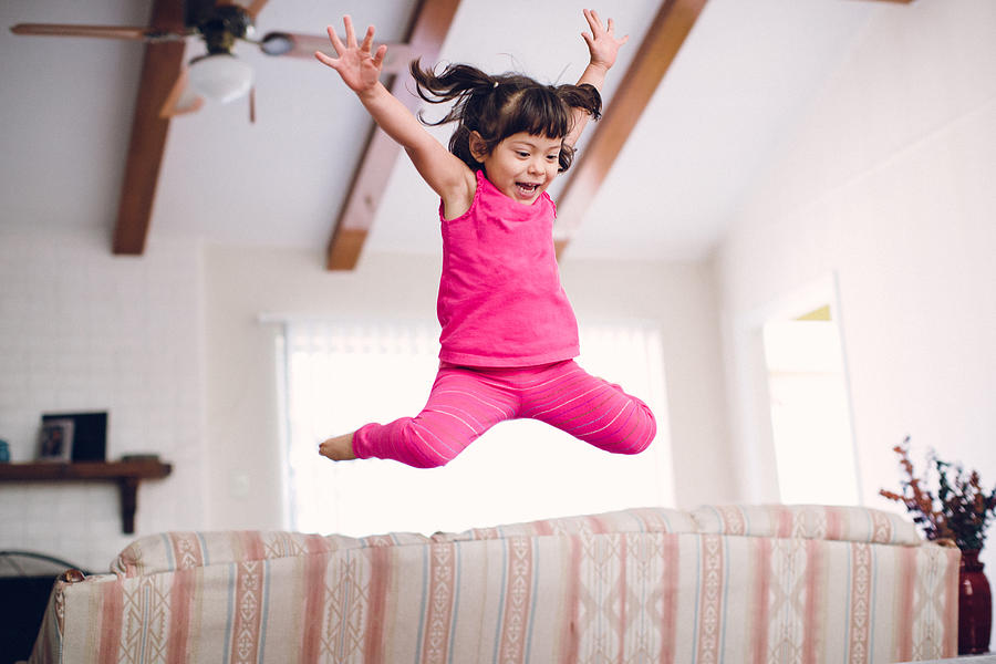 Toddler Jumps High Off The Sofa Photograph by Laura Olivas