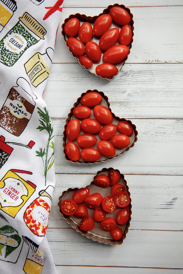 Tomatoes In Heart Tins Photograph