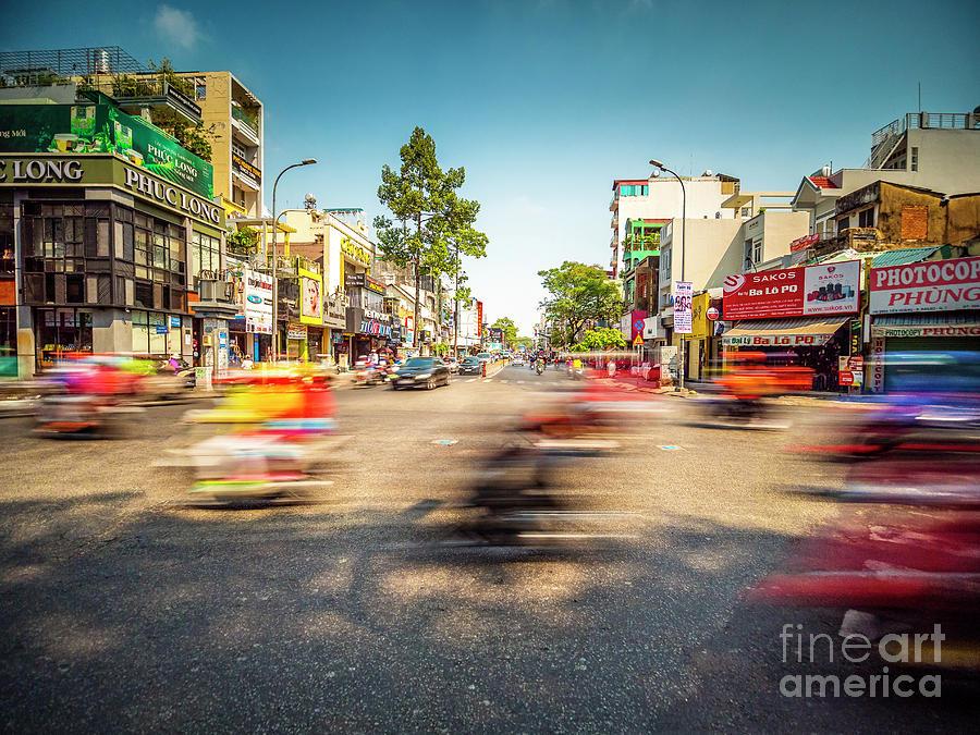 Traffic at Ho Chi Minh City aka Saigon Intersection in Vietnam by Bryan Mullennix