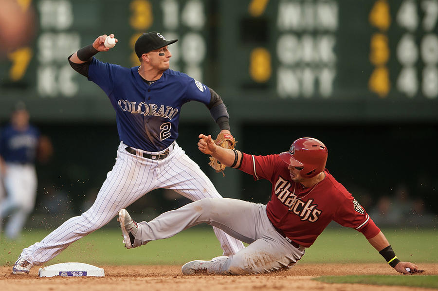 Troy Tulowitzki and Martin Prado Photograph by Dustin Bradford