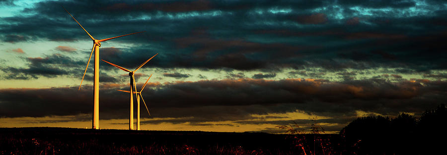 Turbines turn in the Sunset by Max Blinkhorn