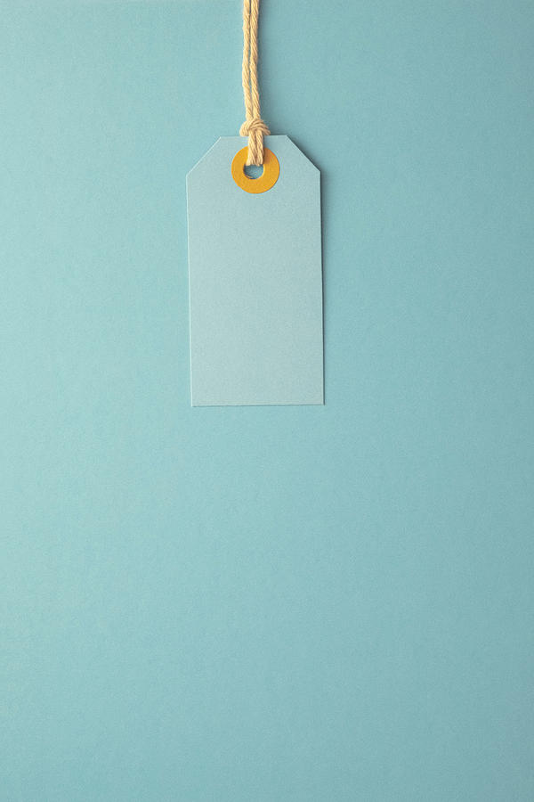 Turquoise Paper Label on a Turquoise Background Photograph by Image by Catherine MacBride