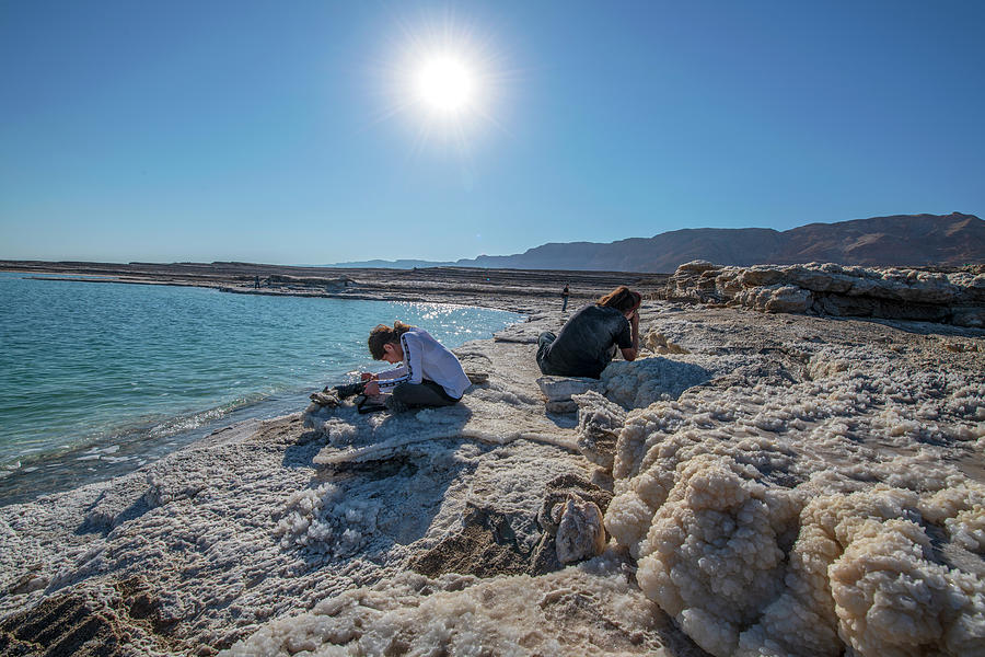 Two Photographers at the Dead Sea by Dubi Roman