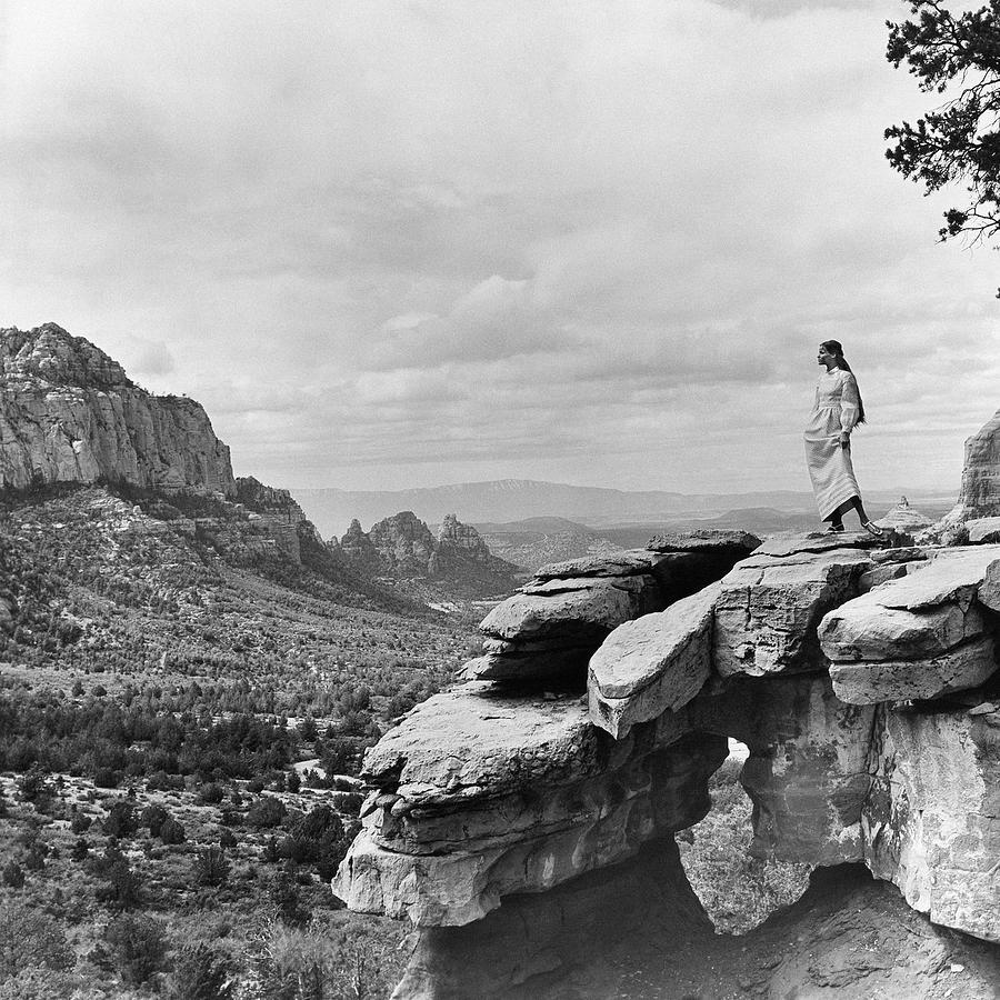 Veruschka on a Barren Cliff in the Arizona Desert Photograph by Franco Rubartelli