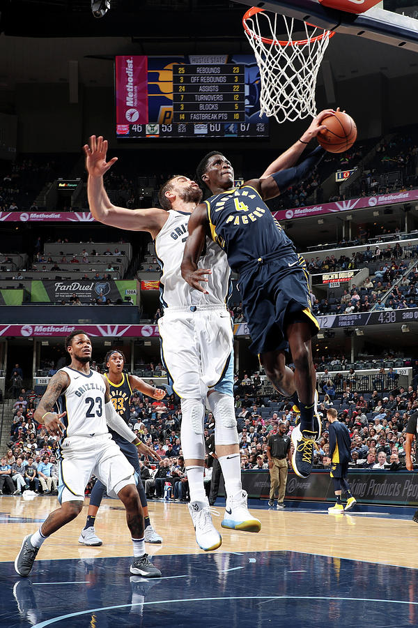Victor Oladipo and Marc Gasol Photograph by Joe Murphy