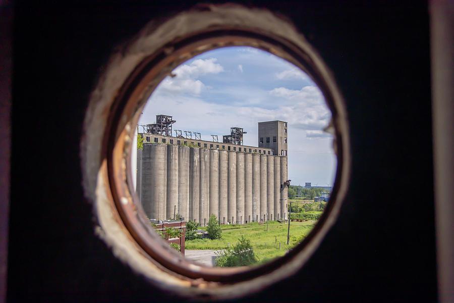 View Of Grain Silo Through Port Hole Photograph