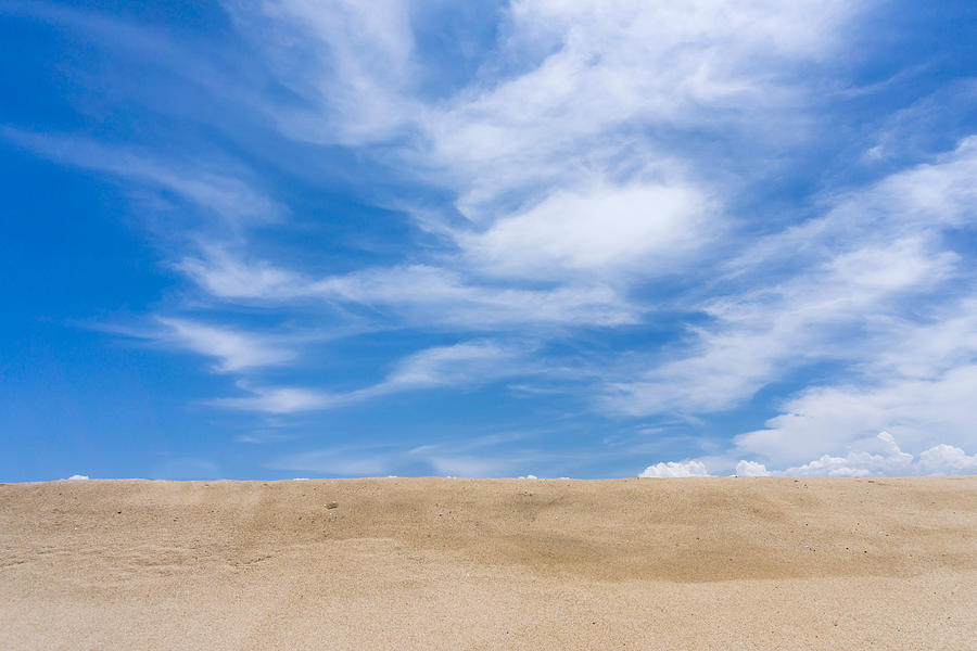 View Of Sand Against Blue Sky And Clouds Photograph by Jesse Coleman / Eyeem