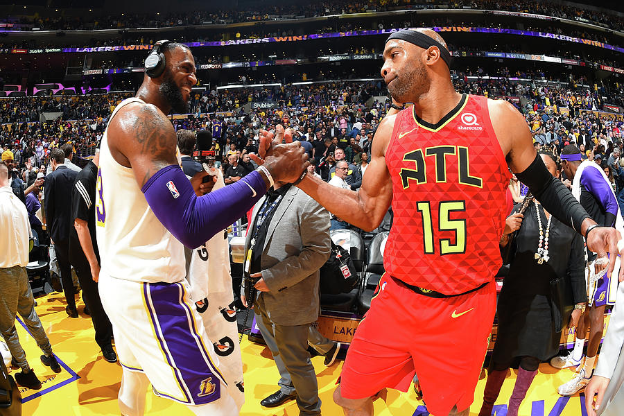 Vince Carter and Lebron James Photograph by Andrew D. Bernstein