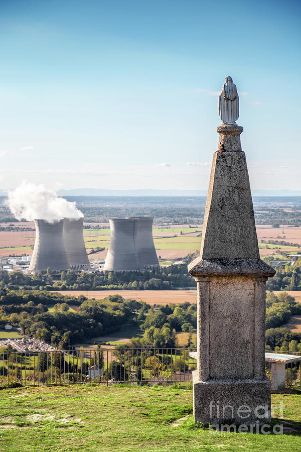 Virgin Mary statue with nuclear power station in background by Gregory DUBUS