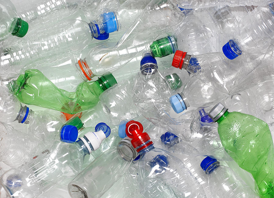Water Bottles In Recycling Bin With Recyclable Caps Photograph by Peter Dazeley