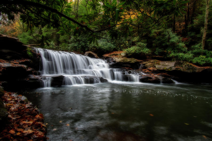 Water Falling Over The Rocks Photograph