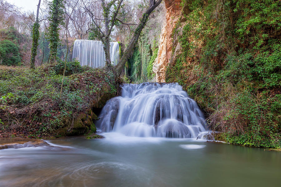 Waterfall Bano de Diana in the stone monastery by Vicen Photography