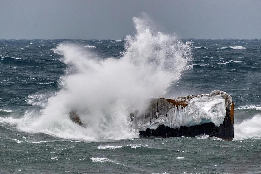 Wave on a boulder by Paul Freidlund
