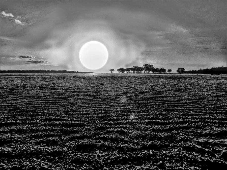 Weipa Large Sun Sets Black And White by Joan Stratton