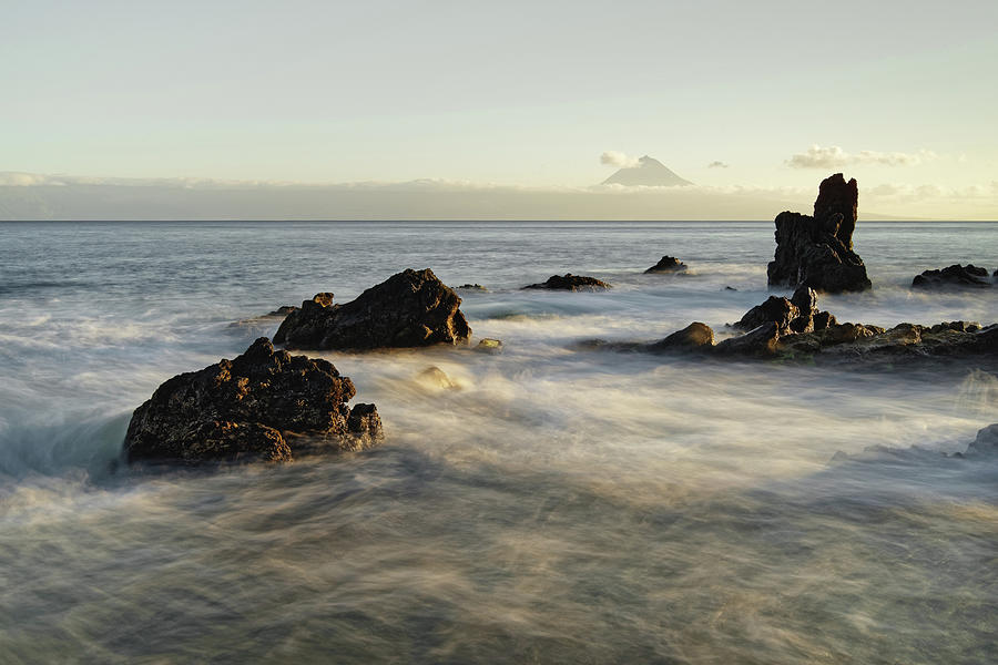 Beach Photograph - Wild coast with mountain silhouette in the evening light by Ralf Lehmann