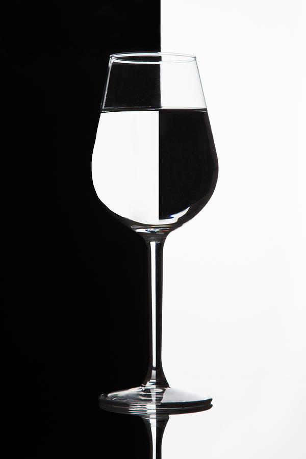 Wine Glass With Domino Effect. Wineglass With Liquid - Refraction. Photograph