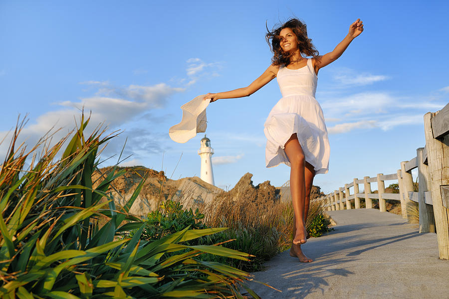 Woman by the Lighthouse, New Zealand Photograph by 4fr