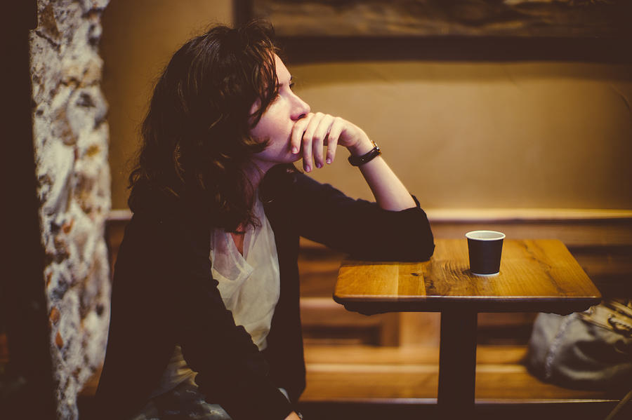 Woman deep in thought at the bar Photograph by Photo by Rafa Elias