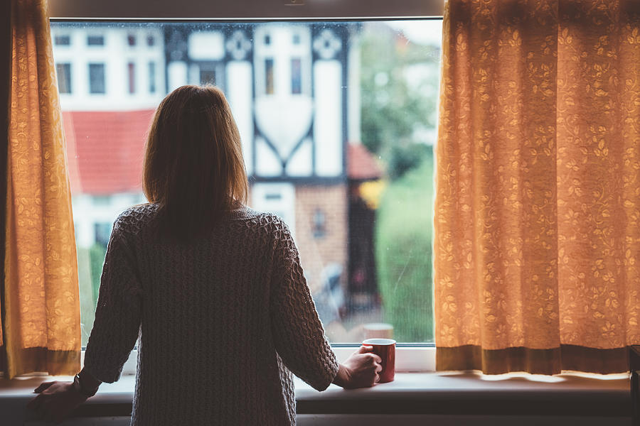 Woman drinking tea at home Photograph by Martin-dm