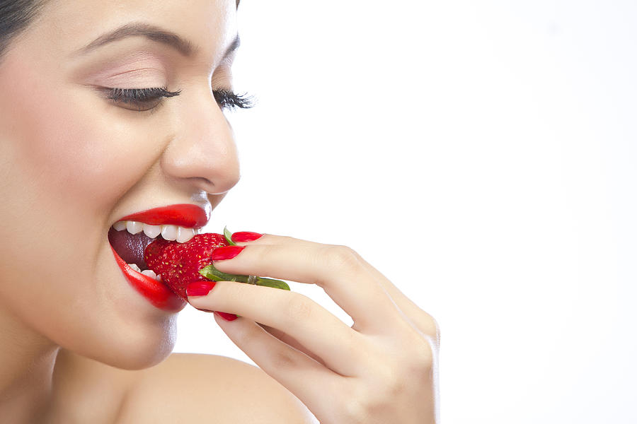 Woman eating a strawberry Photograph by Sudipta Halder