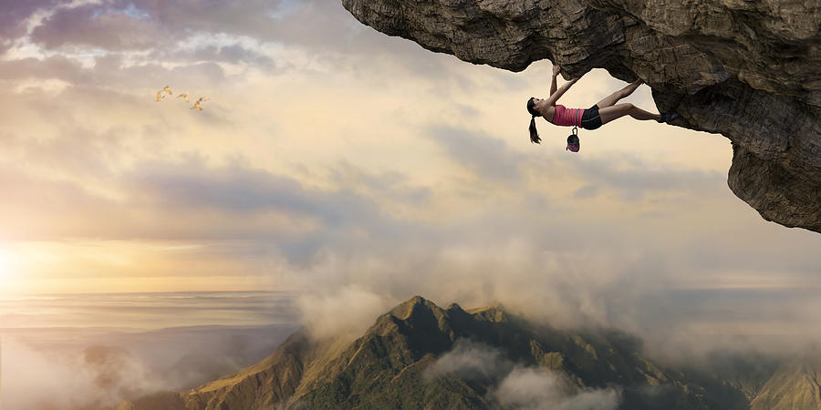 Woman Free Climber Climbs Overhang High Above Mountains at Dawn Photograph by Peepo