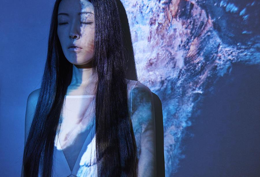 Woman in front of projection with Underwater model Photograph by Masahisa Iketani