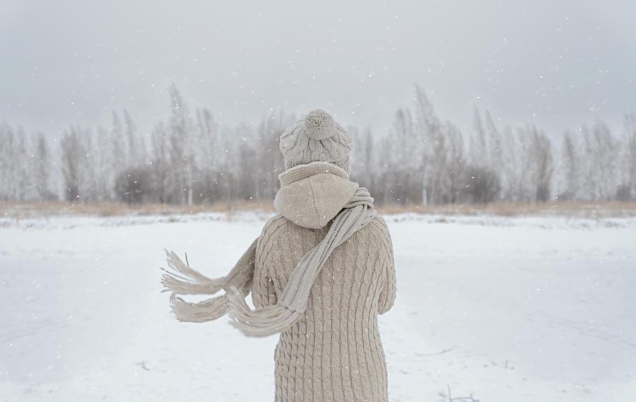 Woman on a meadow in winter Photograph by Remains