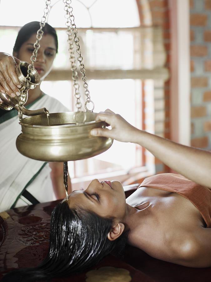 Woman Receiving Shirodhara Ayurvedic Treatment Photograph by Matthew  Wakem