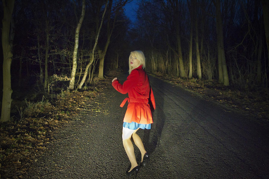 Woman running in fear in woods at night Photograph by Leon Harris