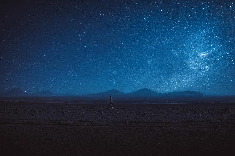 Woman walks under the million stars and Milky Way in Atacama desert Photograph by Anastasiia Shavshyna