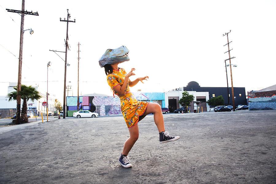 Woman wearing a dinosaur mask Photograph by Stephen Zeigler