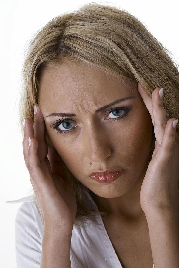 Woman with headache Photograph by Aisenegger