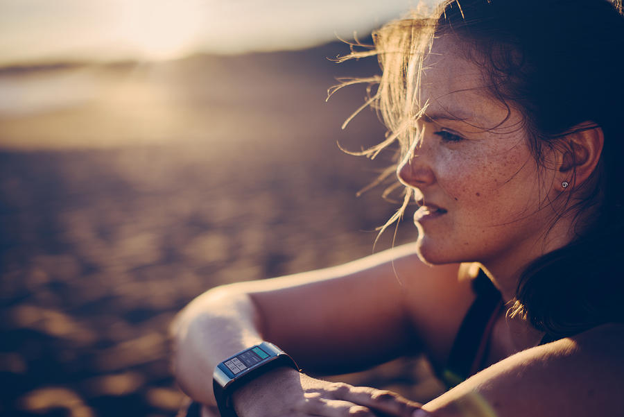 Woman with smartwatch Photograph by Guido Mieth
