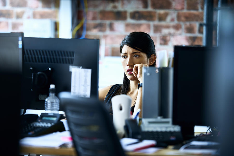 Woman working in modern office Photograph by 10000 Hours
