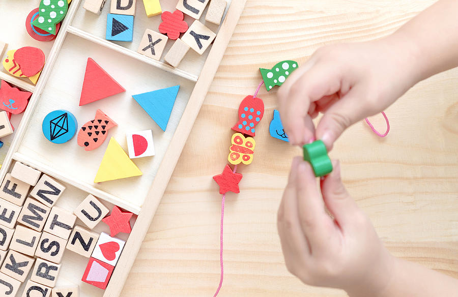 Wooden bead toy Photograph by Krit of Studio OMG
