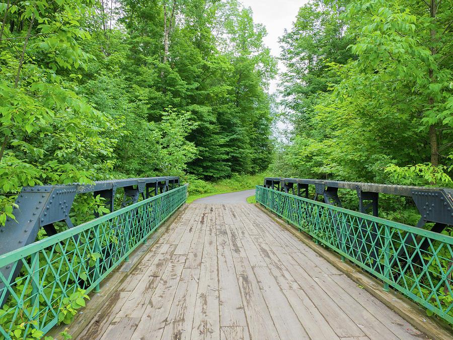 Bridge Photograph - Wooden Bridge Along A Trail In Vermont, Usa by Christian Ouellet