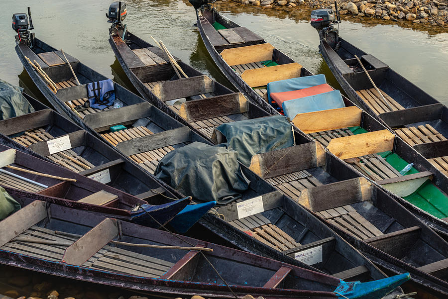 Wooden long boats parked at Kuala Tembeling jetty. Photograph by Shaifulzamri