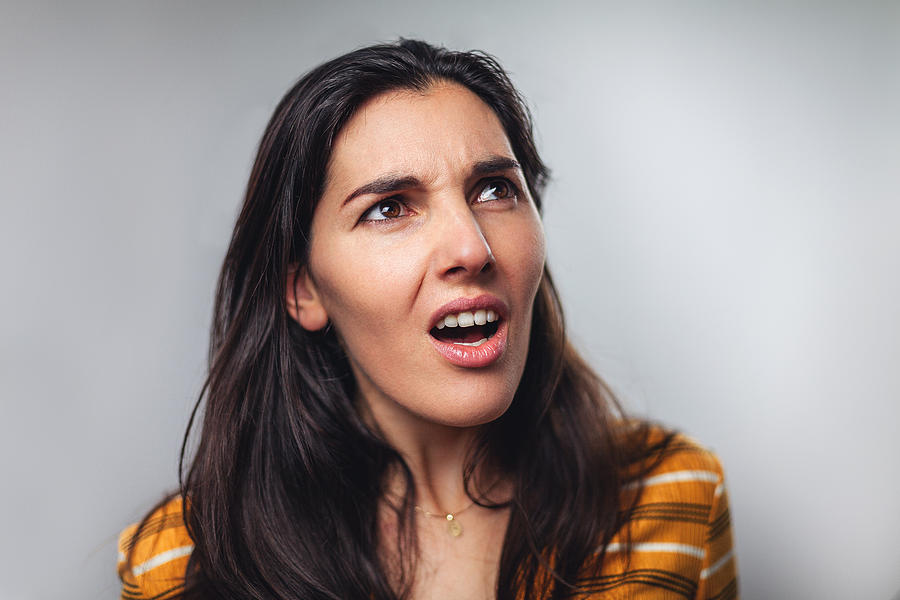 WTF! Head shot portrait of shocked frustrated woman Photograph by Circle Creative Studio