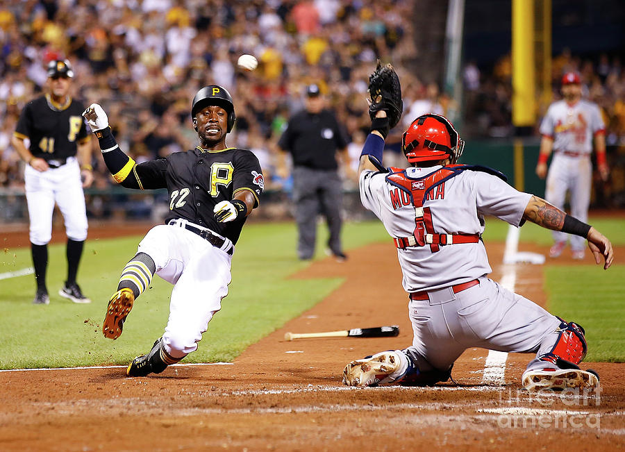 Yadier Molina and Andrew Mccutchen Photograph by Jared Wickerham
