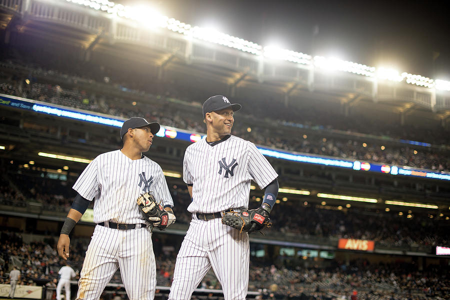 Yangervis Solarte And Derek Jeter Photograph by Rob Tringali