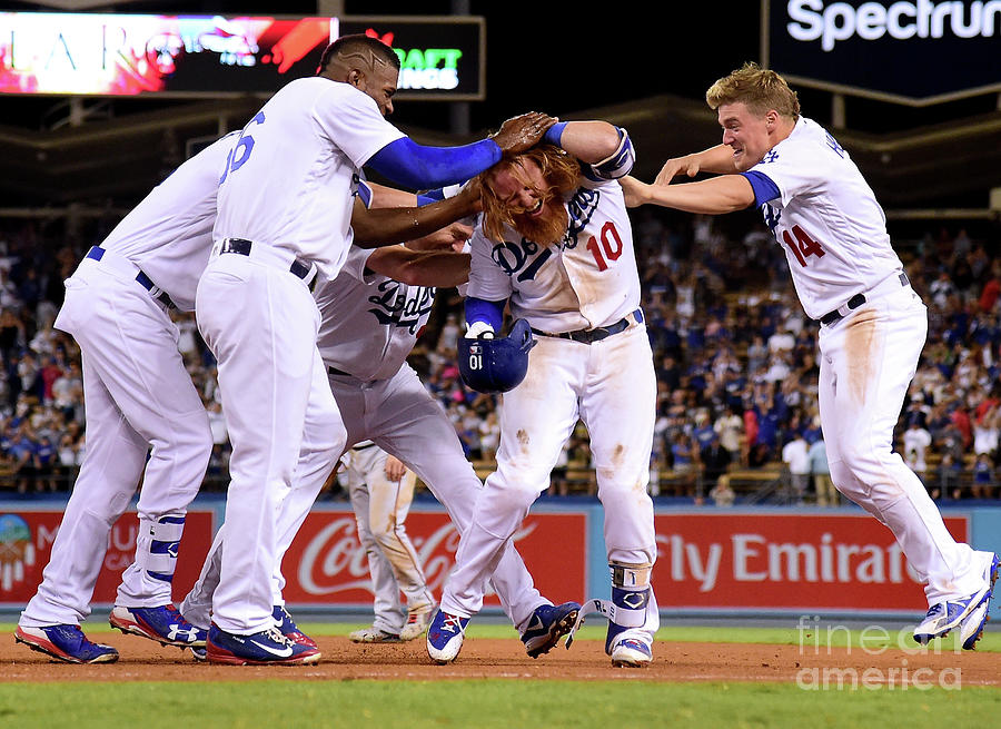 Yasiel Puig and Justin Turner Photograph by Harry How