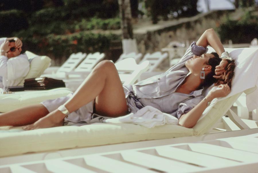 Yasmin Le Bon Lounging on a Beach Photograph by Arthur Elgort